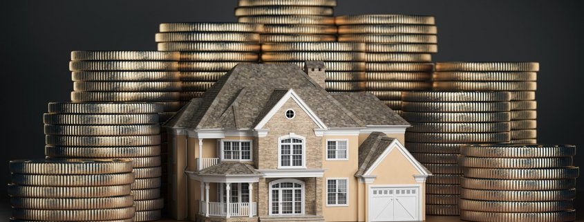 Real estate investments and mortgage concept. House and stack of coins.